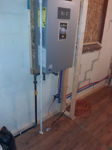 May, 2021, West Hickory, PA  16351. Agreed upon proposal: Completed the three shutoff valves and gas lines, installed tankless water heater, and connected new waste and water lines from outside to inside.  Workmanship guarantee.  Customer will be completing other work not in the contract.